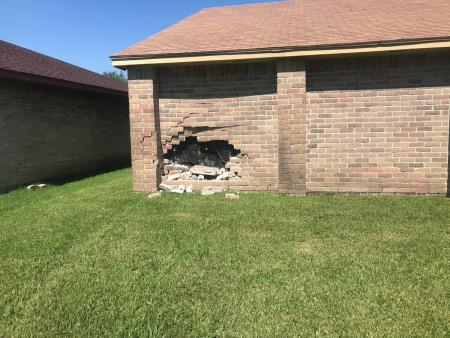 Driver Crashes Into House